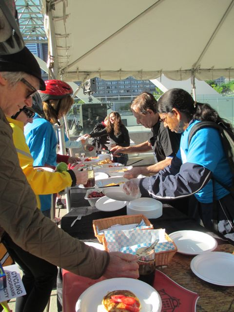 Volunteers distribute breakfast