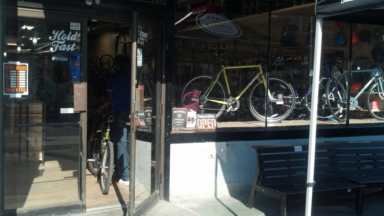 A cyclist enters the bike shop